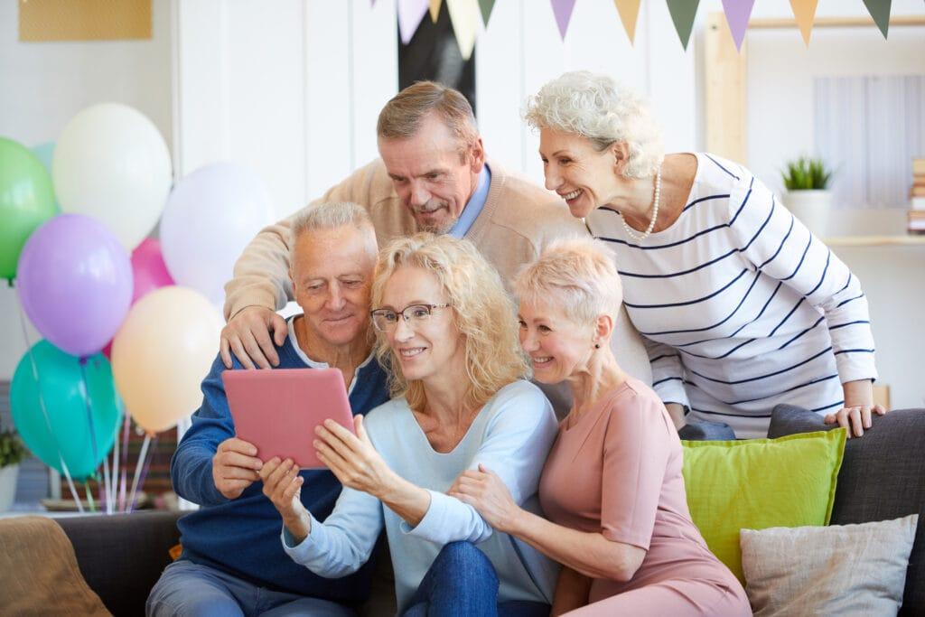 webbabyshower grandparents video chat holding tablet
