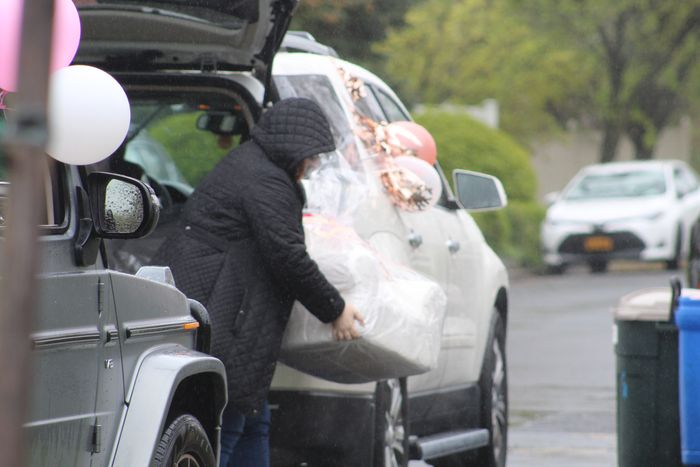 WebBabyShower guest dropping gifts in rain during drive by baby shower