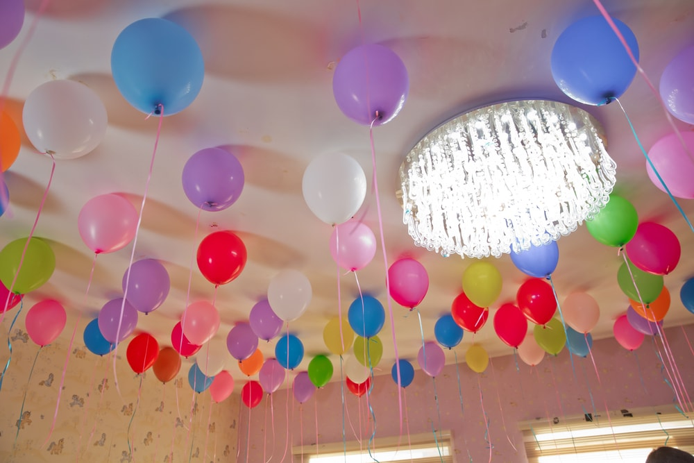 webbabyshower party venue with balloons at the ceiling