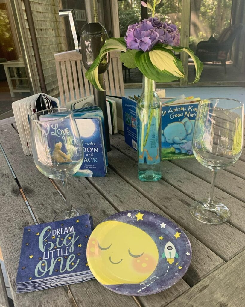 table with books for baby shower
