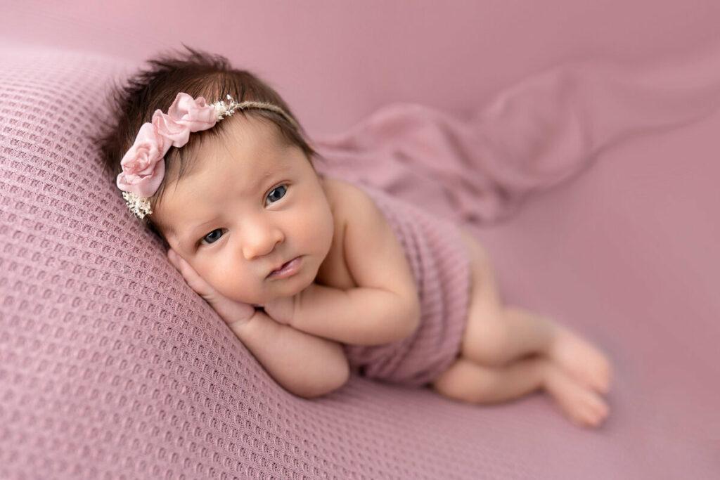 webbabyshower baby in pink awake for newborn photoshoot