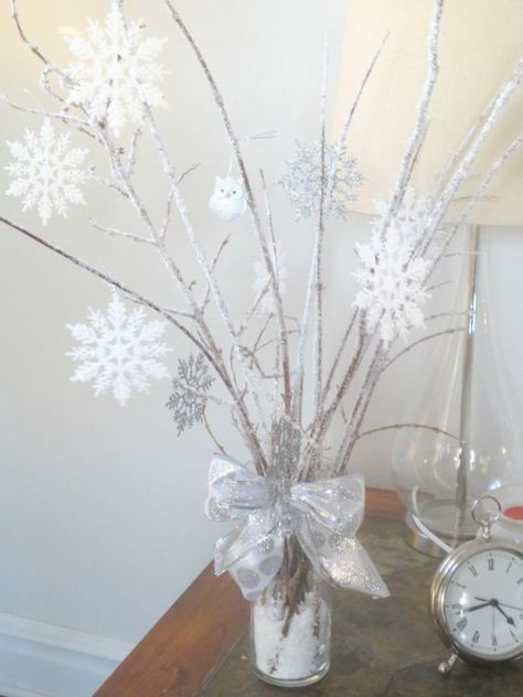 winter baby shower hanging snowflakes twigs