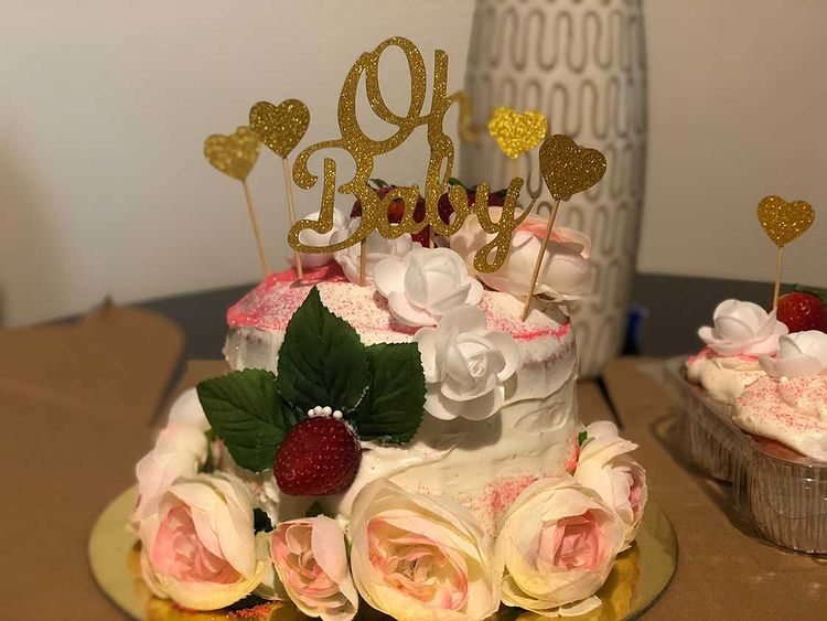husband throws a baby shower cake