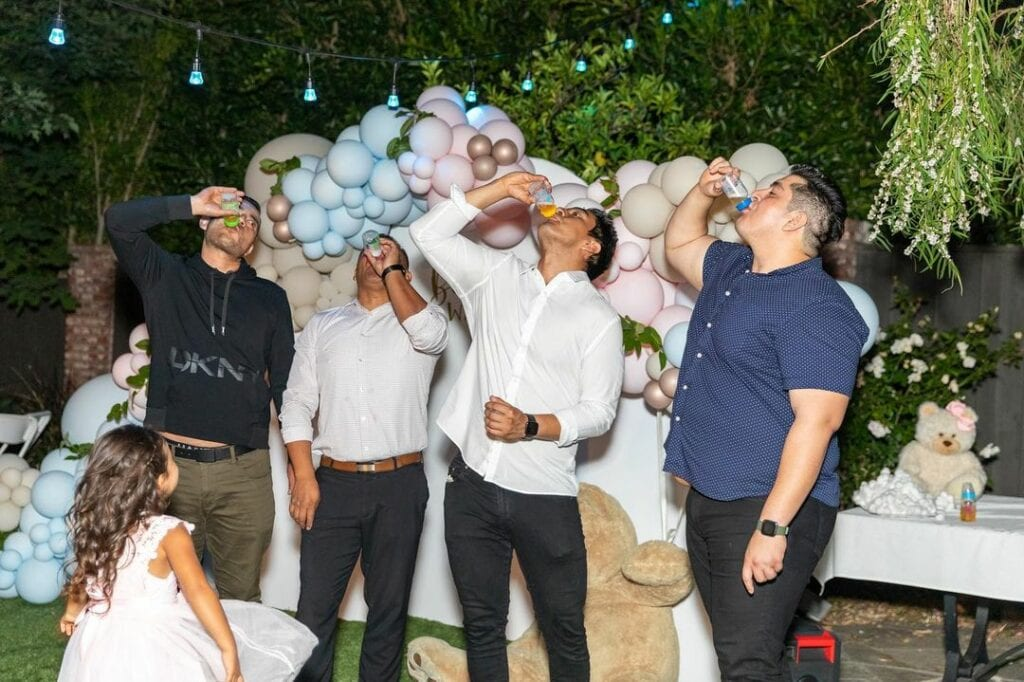 baby bottle chugging contest at a baby shower