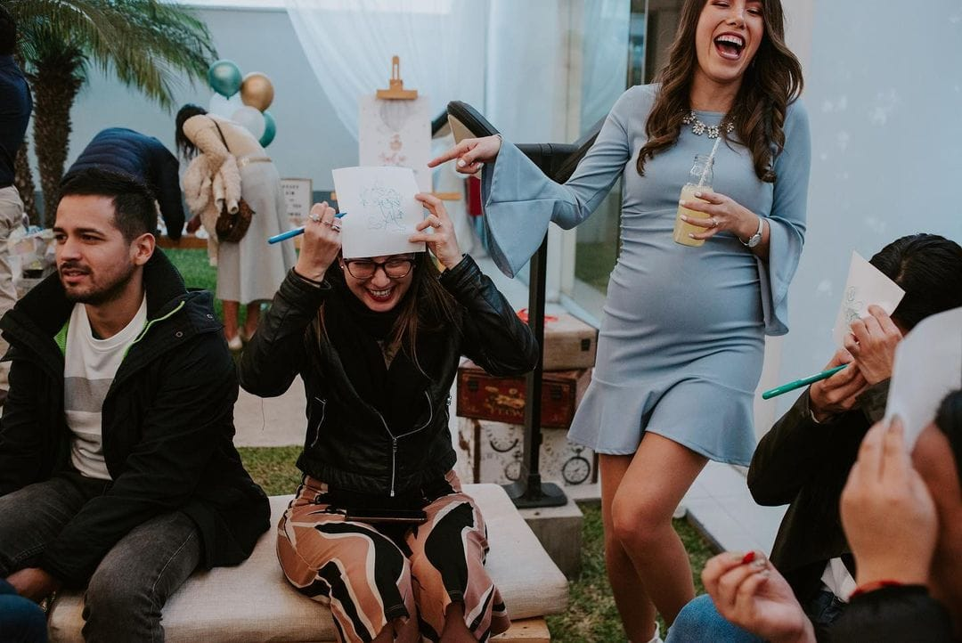 mom-to-be laughing during draw the baby game