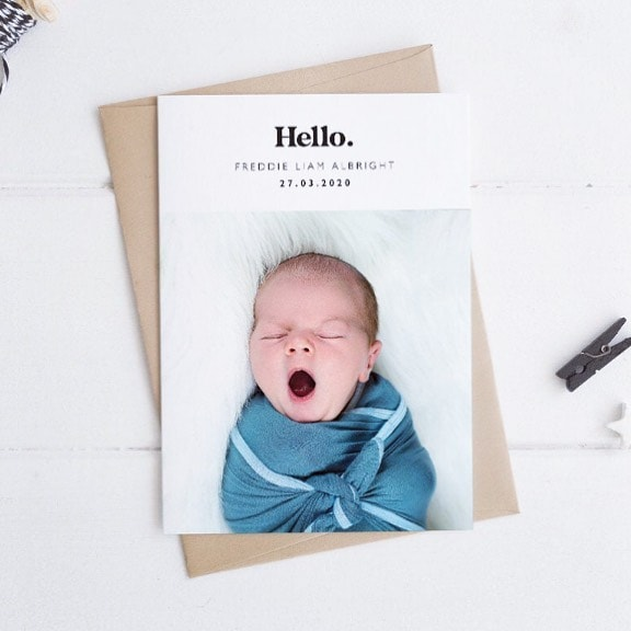 minimal birth announcement with a baby picture and little details